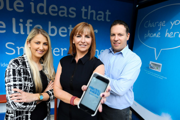 26/08/2015 NO REPRO FEE, MAXWELLS DUBLIN/JULIEN BEHAL. Pictured at the Electric Ireland Smarter Living phone charging bus stops were (l to r) Jennifer Byrne, Senior Account Executive PML, Lisa Browne, Head of Marketing Electric Ireland and Pat Cassidy, Digital, Innovation and Experiential Manager PML. Based on the premise of 'Simple ideas that make life better', the Electric Ireland Smarter Living bus shelters allow commuters to charge their phones as they wait for their bus with a built in charging dock for Apple and Android phones and include a range of 'smarter' tips in the creative, all submitted by Electric Ireland customers around the country. There are five Electric Ireland Smarter Living charging bus stops located at Camden Street, Clontarf Road, Stillorgan Road, Raheny and Harold's Cross. PIC: NO FEE, MAXWELLS/JULIEN BEHAL.For more information please contact: Elisabeth Fitzpatrick (WH) 0866092571