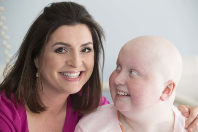 NO REPRO FEE 18/8/2014.TV Presenter Collette Fitzpatrick meets with Rebecca Boyd 14yrs from Tralee in Kerry as the presenter dropped into Our Lady`s Children`s Hospital Crumlin as  TV3 announced that  the hospital  fundraising body, CMRF,  Children's Medical & Research Foundation as its Official Charity for the year. CMRF has highlighted a 2million shortfall in its fundraising target to mark its selection by TV3 as the station's official charity for the next 12 months From 1st September TV3 will lend its support to The CMRF which will involve many of the station`s well known personalities in fundraising activities . As part of its commitment they will develop a number of initiatives to help raise much-needed funds for The CMRF over the next year and support the charity`s important campaigns. Photo: Leon Farrell/Photocall Ireland.