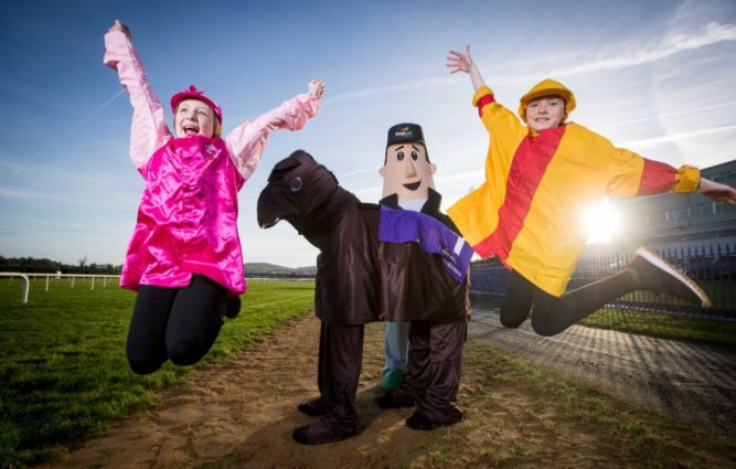 Top Oil Charity Mascot Race aims to raise significant funds for an Irish charity this Christmas at the Leopardstown Christmas Festival - Call for company mascots to 'Go Head to Head with Mr. Ted 9/12/2016 Roisin Black and Casey Kavanagh with Mr Ted Mandatory Credit ©INPHO/Morgan Treacy