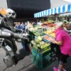NO REPRO FEE. 1/6/2016. Moore Street trader Marie Cullen gets a shock when Titan a 8ft Robot walks up to her stall in Dublin. Titan was in the city centre to launch this years Laya Healthcare's City spectacular, which takes place in Dublin's Merrion Square on July 8th-10th and in Cork's Fitzgerald Park on July 16th and 17th. For more information on this free event go to www.cityspectacular.com.Photo: leon Farrell/Photocall Ireland.